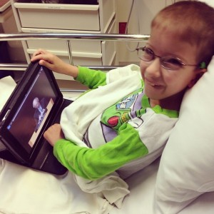 Isaiah watching his sermons before surgery.